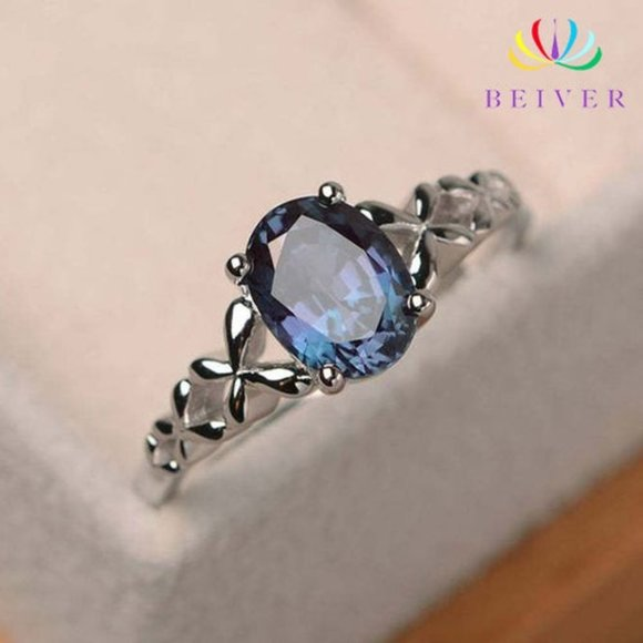 .925 Sterling silver ring with a Blue stone